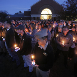 Hundreds of students, faculty and alumni attend a vigil Tuesday at Maine Maritime Academy in Castine, the alma mater of four Mainers aboard the lost El Faro: Capt. Michael Davidson of Windham, Michael Holland of Wilton, and Danielle Randolph and Dylan Meklin, both of Rockland.