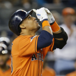 The Astros' Carlos Gomez hits a solo home run in the fourth inning of Tuesday night's American League wild card game. Houston went on to a 3-0 win and a spot in the AL Division Series.