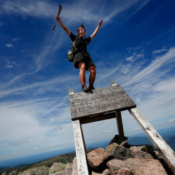 Jesse Metzler, 19, of Newton, Mass., celebrates atop Mount Katahdin after completing a hike of the Appalachian Trail on July 29. A reader who is an avid hiker and trail angel believes trail rules should be enforced.