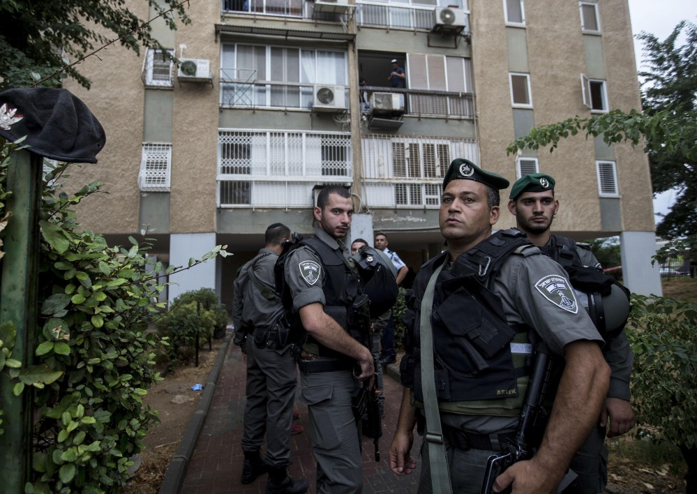 Israeli police stand at the scene of an attack in Kiryat Gat, Israel, on Wednesday. A Palestinian man who stabbed a soldier was shot and killed by Israeli security forces.