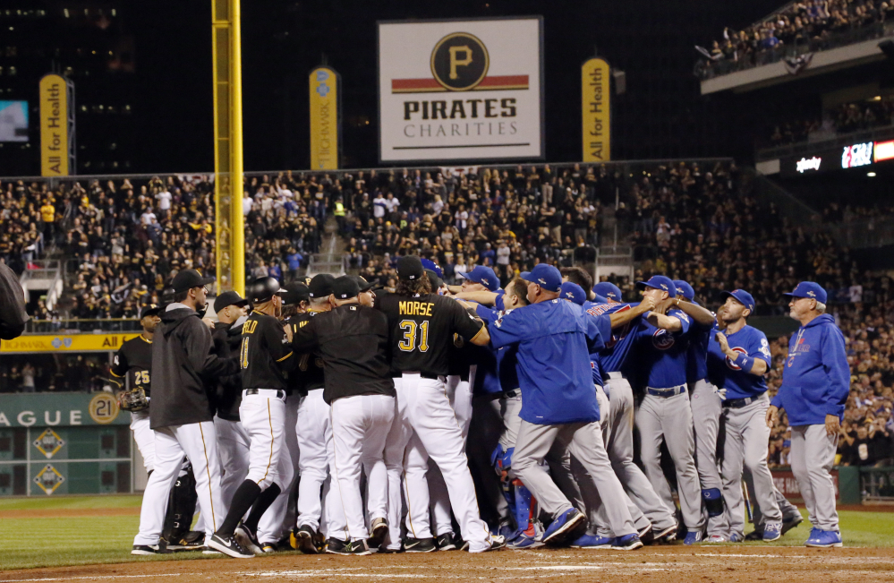 Players from both teams swarm the field after Cubs pitcher Jake Arrieta was hit by a pitch by Pirates relief pitcher Tony Watson in the seventh inning. Arrieta finished the game, completing a four-hit shutout.