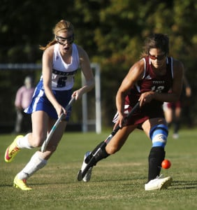 Chloe Smith of Kennebunk, left, moves the ball up the field as Alyssa Coyne of Greely defends during the first half. Derek Davis/Staff Photographer