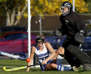 Olivia Sandford of Kennebunk and Greely goalie Lizzie Brown keep their eyes on the ball after Brown made a save during the first half on Wednesday. Sandford had a goal and an assist in the Rams' 2-0 victory.