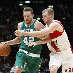 "David Lee of the Boston Celtics drives on Olimpia Milano's Robbie Hummel during a 124-91 win by Boston as part of the NBA Global Games on Tuesday in Assago, Italy. Lee, who won a title with Golden State last season, says his new Boston team has ""great chemistry."""