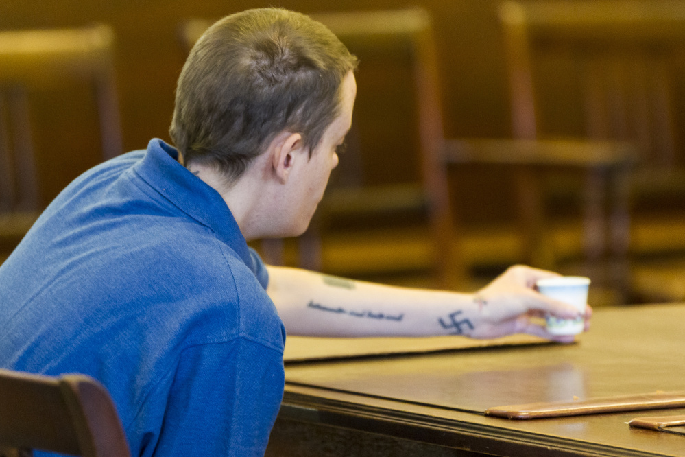 ALFRED, ME - OCTOBER 8: A tattooed swastika is visible on the left arm of Connor MacCalister, 31, of Saco, while she reaches for a drinking cup in the courtroom at York County Court. Connor eventually pleaded guilty of murder in the stabbing death of a woman in a Saco supermarket. (Photo by Ben McCanna/Staff Photographer)