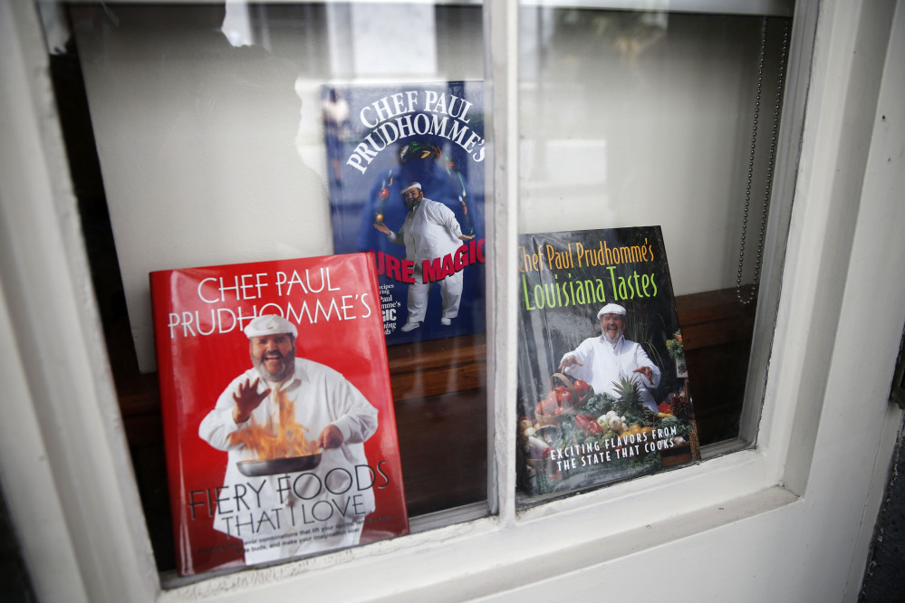 Cookbooks by Chef Paul Prudhomme are displayed in a window at K-Paul's Louisiana Kitchen in the French Quarter of New Orleans on Thursday.