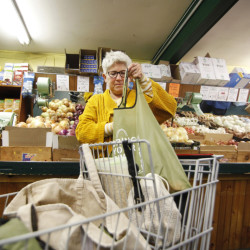 Victoria Simon readies her reusable shopping bags during a trip to Golden Harvest in Kittery.