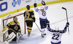 Winnipeg Jets center Nicolas Petan, second from right, celebrates with teammate Chris Thorburn (22) after his goal against Bruins goalie Tuukka Rask in the third period of Thursday night's game in Boston.