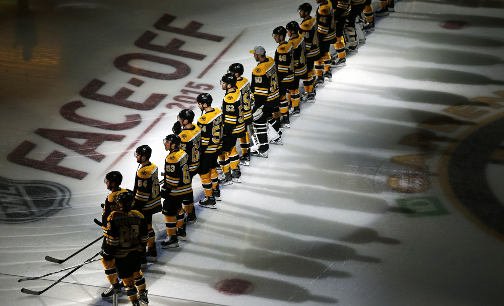 Bruins players line up for introductions before the opening game of the season.