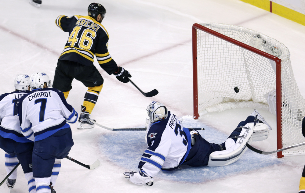 Bruins center David Krejci beats Jets goalie Ondrej Pavelec for a goal in the first period. Boston took an early 1-0 but soon fell behind.
