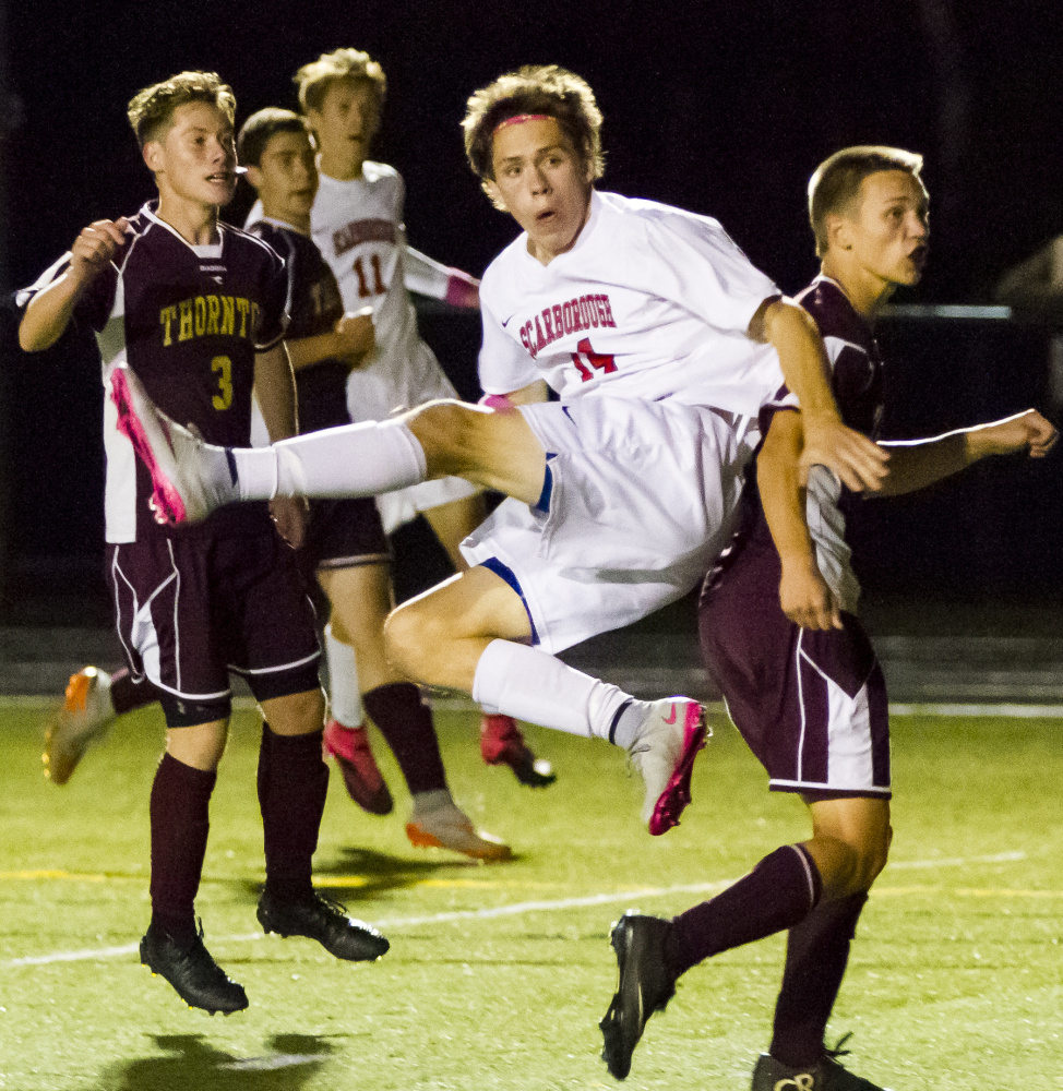 Jake Kacer of Scarborough watches his second-half header sail into the net Thursday night, clinching a 2-0 victory against Thornton Academy. Jacob McGarvey scored in the first half for the Red Storm.