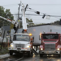 PORTLAND, ME - OCTOBER 9: Truck accident at corner of Brighton and Stevens Avenues. Workers prepare to remove the utility pole snapped off by the truck, right, on a sharp turn.(Photo by)