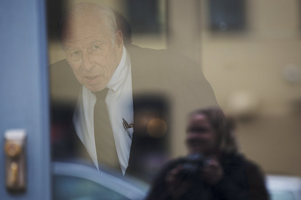 "Russell ""Rusty"" Brace, 82, looks out the door toward reporters before leaving U.S. District Court in Portland on Friday."