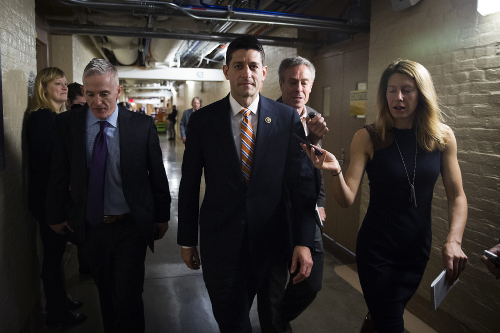 Rep. Paul Ryan, R-Wis., center, and Rep. Trey Gowdy, R-S.C., arrive for a House Republican meeting on Capitol Hill  on Friday. The pressure is on Ryan to run for House speaker.
