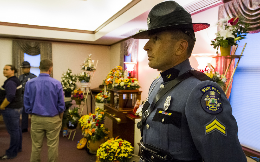 Cpl. Set Edwards, a K9 trainer for the Maine State Police, serves as an honor guard at Fortin Funeral Home on Friday during a wake in memory of Colton Guay. Dozens of law enforcement officers attended the wake for the toddler, whose father, Jon Guay, is a deputy with the Androscoggin County Sheriff's Office.  Ben McCanna/Staff Photographer