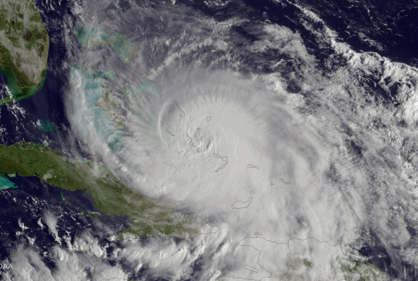 Scientists say severe weather, such as deadly Hurricane Joaquin, is intensified by climate change. A reader urges helping young people to actively address their worries about this.
