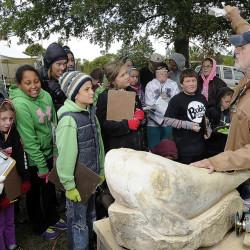 Gerry Hoff, an artist from Mount Vernon who is also a retired art teacher and owner of Maine Bone Carving, explains his work to students from Marcia Buker Elementary School in Richmond, as they take part in a symposium that included hands-on art instruction at the Viles Arboretum in Augusta.