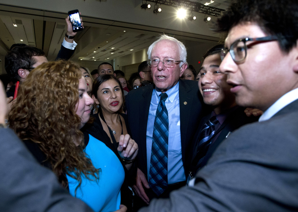 Democratic presidential candidate Sen. Bernie Sanders, I-Vt. greets people after he spoke at Congressional Hispanic Caucus Institute Public Policy Conference at Washington Convention Center, Wednesday, Oct. 7, 2015, in Washington. ( AP Photo/Jose Luis Magana)