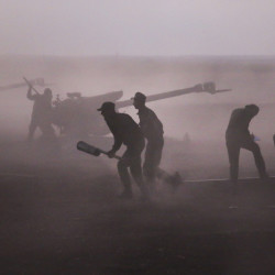 Syrian army personnel load howitzers Wednesday near the village of Morek in Syria. The army, aided by Russian airpower, launched attacks in the northwestern part of the country this week, but Islamic State militants went on a surprise offensive Friday.