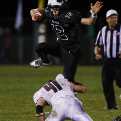 STANDISH, ME - OCTOBER 9: Bonny Eagle quarterback Cam Day, jumps over Wyndham's Patrick Levitt during the third quarter of their game Friday, October 9, 2015 in Standish, Maine. Photo by Joel Page/Staff Photographer)