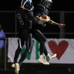 STANDISH, ME - OCTOBER 9: Bonny Eagle Ben Autry, left, celebrates with Eben Cram, right, following his touchdown in the first quarter of their game agains Windham Friday, October 9, 2015 in Standish, Maine. (Photo by Joel Page/Staff Photographer)