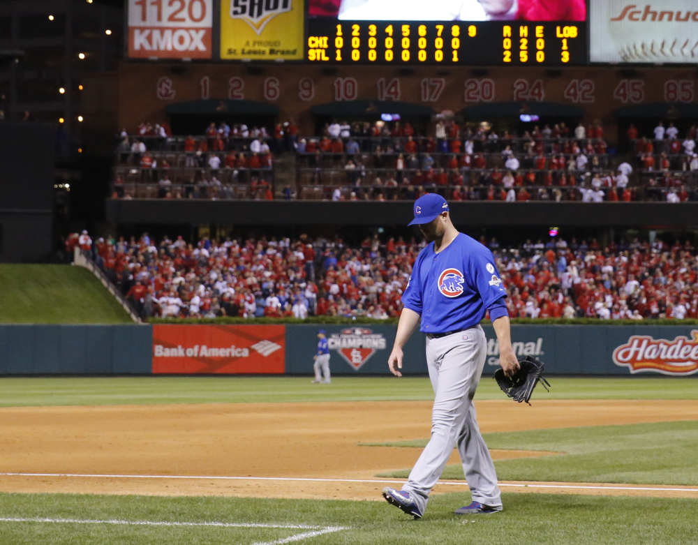Cubs starter Jon Lester walks to the dugout after being taken out in the eighth inning. The one-time Red Sox ace held the Cardinals to five hits, but his former teammate John Lackey outpitched him.