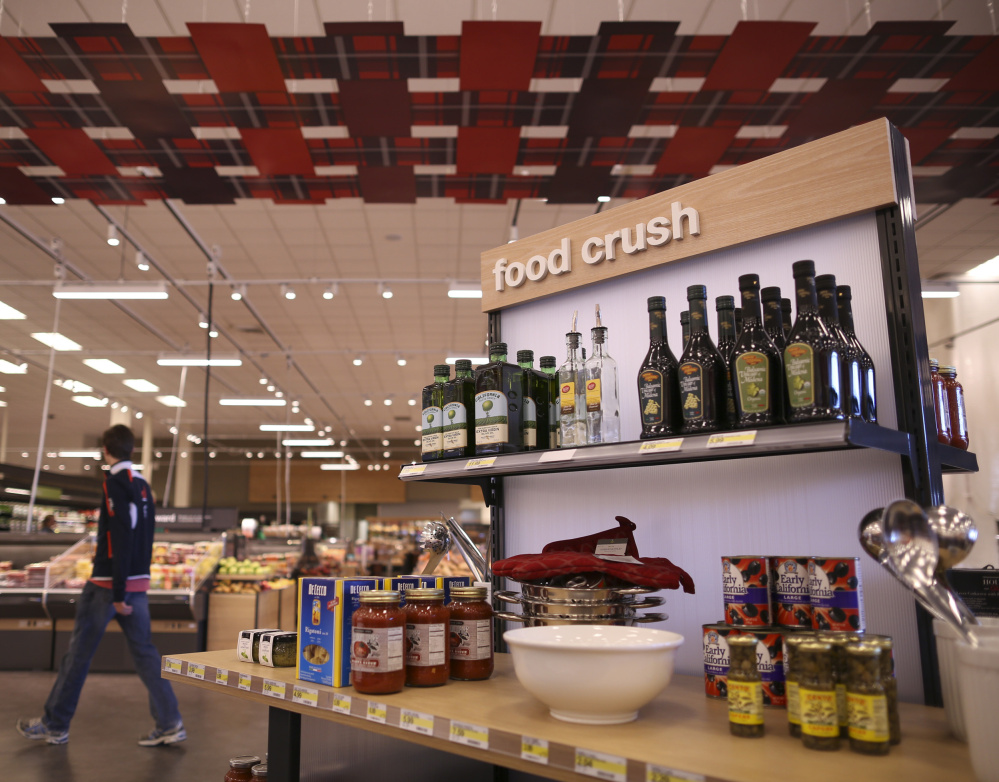 Kiosks like this one in a renovated Minnesota store aim to inspire shoppers. The areas display related food items as well as bowls and sleek place mats.