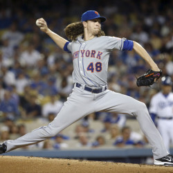 New York Mets starting pitcher Jacob deGrom throws against the Los Angeles Dodgers in the first inning of Friday night's National League Division Series game in Los Angeles.