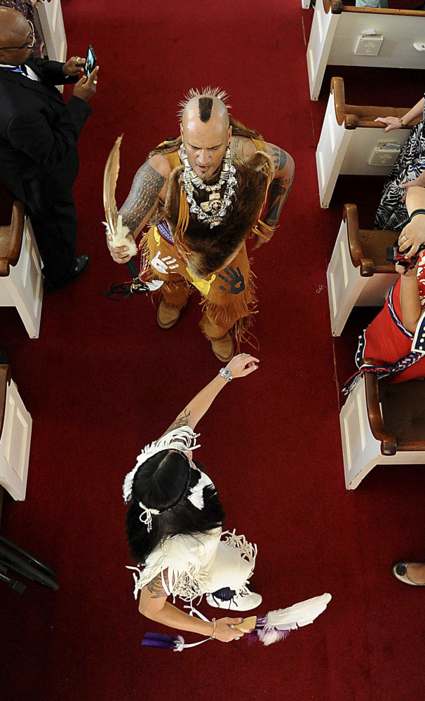 StrongMedicine Bear and WarriorWoman dance after the service. The church's founder brought the Praying Indians to Natick in 1651.