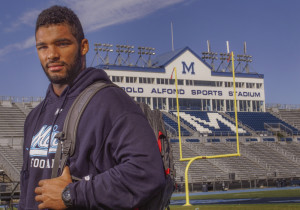 """The University of Maine's Trevor Bates of Westbrook feels removed from the collegiate debate over professional versus amateur. """"I'm just a college football player, that's it,"""" he said."""
