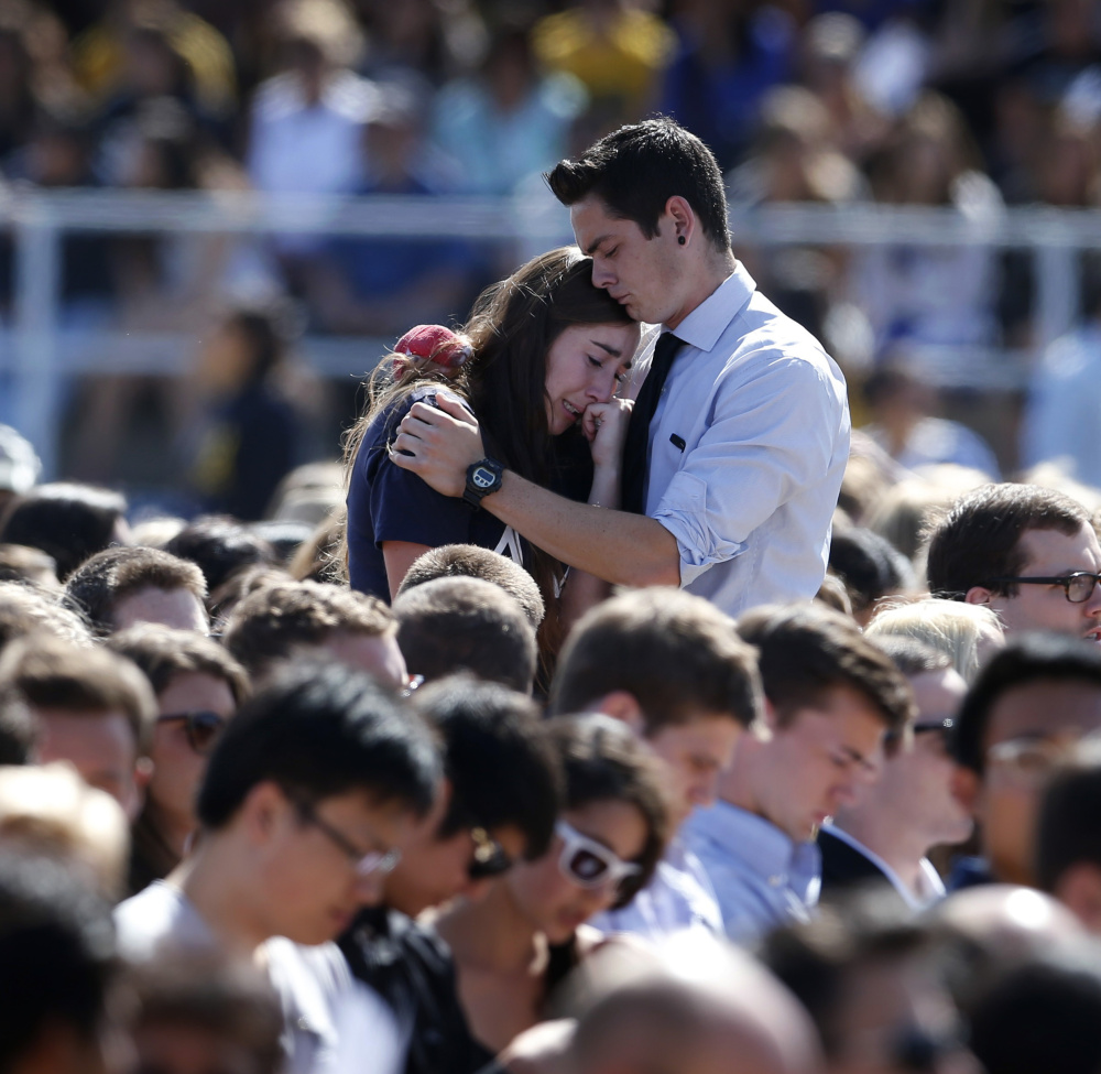 Memorial services like this one at the University of California, Santa Barbara, in 2014 are becoming more common. But U.S. colleges and universities vary widely in how they train their staff and students on what to do if there's a gunman on the loose.