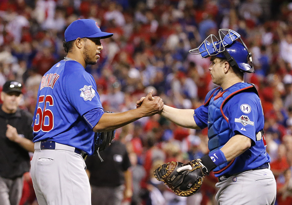 Chicago Cubs' Hector Rondon, left, is congratulated by catcher Miguel Montero after the Cubs defeated the St. Louis Cardinals, 6-3, in Game 2 of the National League Division Series Saturday in St. Louis. The Associated Press