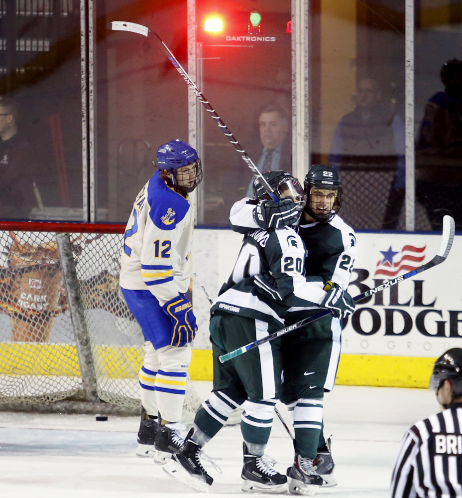 J.T. Stenglein of Michigan State, right, celebrates with Michael Ferrantino after Ferrantino scored in the first period of the 4-1 victory against Lake Superior State on Saturday. The teams met in the first game of the second day of the Ice Breaker tournament at the Cross Insurance Arena.