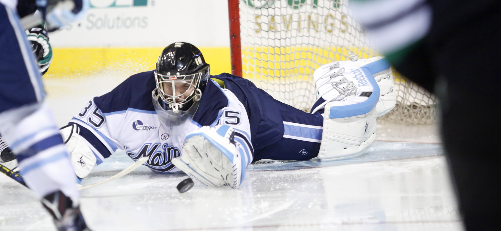 University of Maine goalie Rob McGovern sprawls to make a save in the second period Saturday night. Chris Wilkie scored on the rebound for North Dakota.