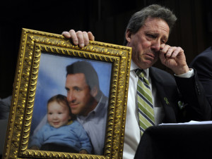 Neil Heslin, the father of Jesse, a 6-year-old boy who was killed in the massacre in Newtown, Conn., testifies in Washington on Feb. 27, 2013. Even that tragedy did not spur Congress to fund CDC research into gun violence.
