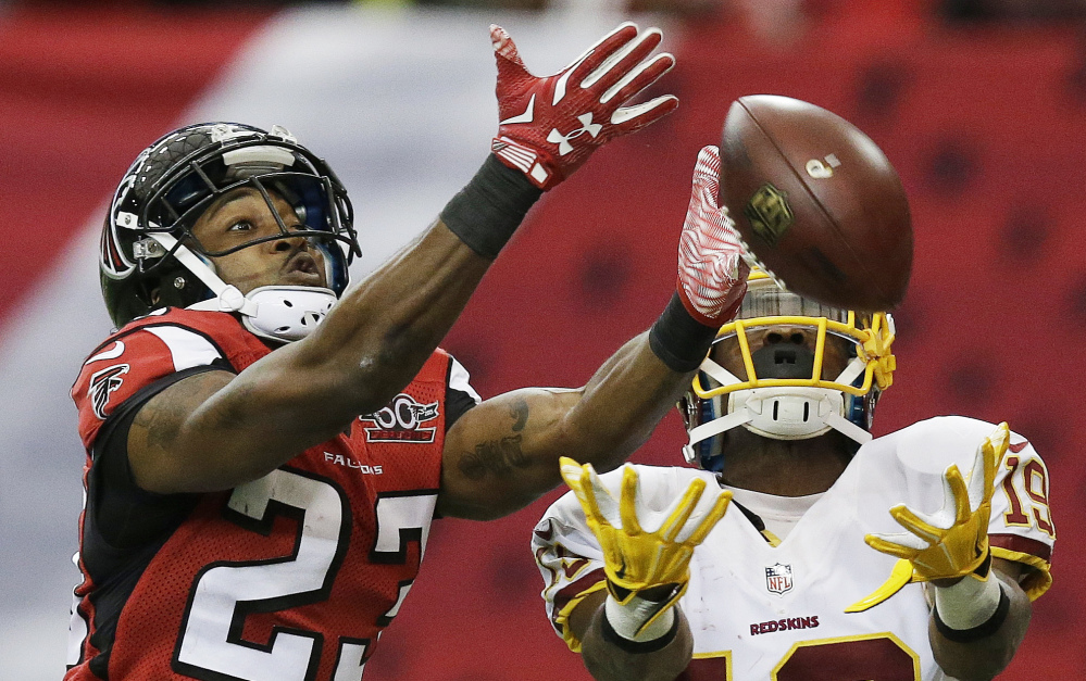 Falcons cornerback Robert Alford, left, breaks up a pass intended for Washington's Rashad Ross. Alford later intercepted a pass and returned it for the winning touchdown in overtime.
