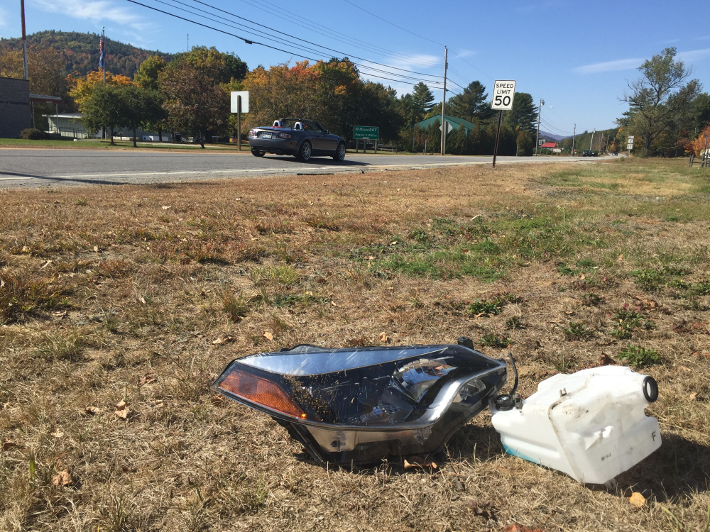 Debris from the accident that killed Paul Stucki remained on the side of Route 2 in Dixfield on Monday.