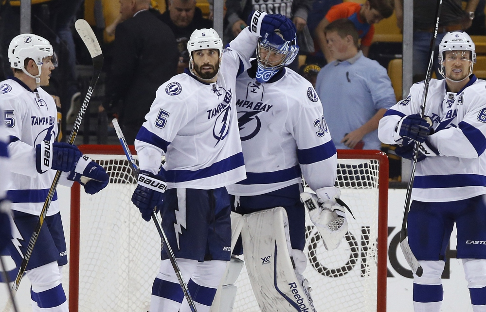 Tampa Bay goalie Ben Bishop and Jason Garrison celebrate their 6-3 win over the Bruins, the Lightning's first win in Boston in more than five years.