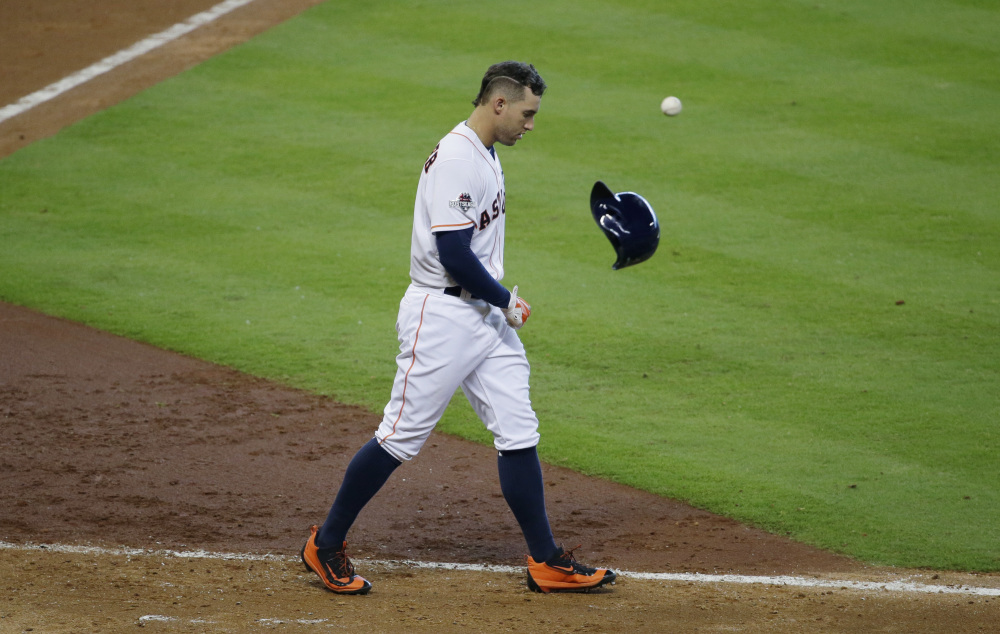 The Astros' George Springer tosses his helmet after striking out to end the eighth inning. Kansas City went on to win and push the series to a decisive fifth game.
