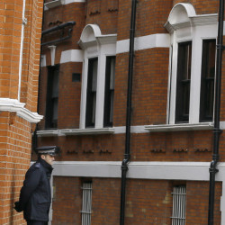 A British police officer stands guard outside the Ecuadorean Embassy in London.