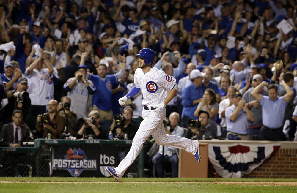 Cubs third baseman Kris Bryant runs the bases after hitting a two-run home run in the fifth inning. It was the third of six home runs by Chicago as the Cubs took a 2-1 lead in the series.
