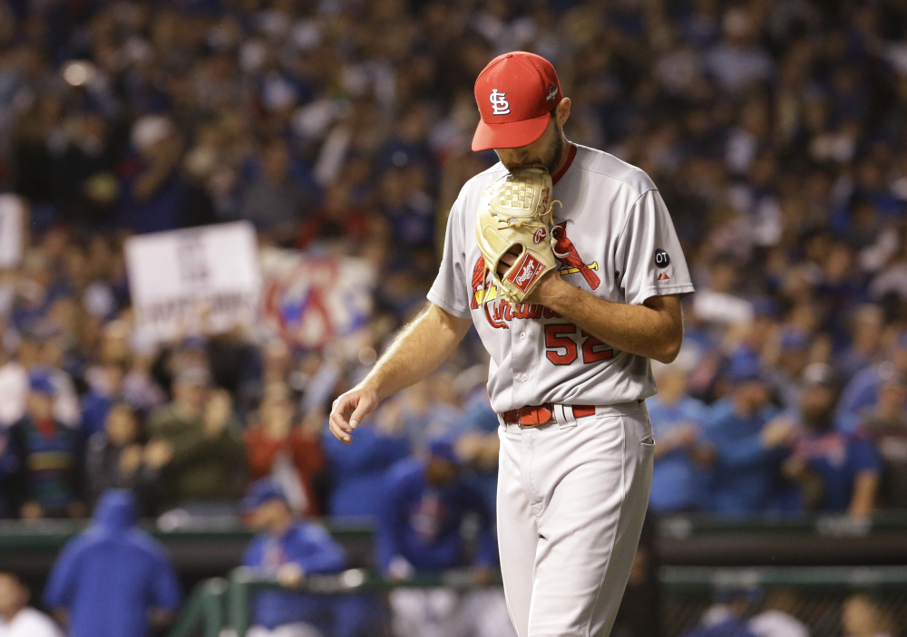 Cardinals starter Michael Wacha is relieved with one out in the fifth inning. Wacha had trouble keeping the ball in the park, giving up three home runs to the Cubs.