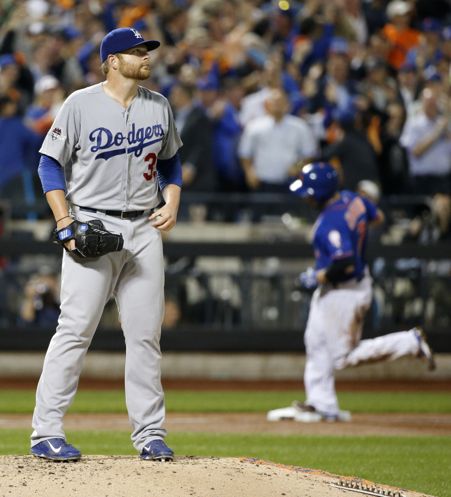 Dodgers starting pitcher Brett Anderson reacts as the Mets' Travis d'Arnaud runs the bases after hitting a two-run home run in the third inning.