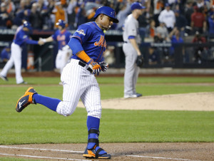 The Mets' Yoenis Cespedes trots down the first base line after hitting a three-run home run off Dodgers pitcher Alex Wood in the fourth inning of Monday night's game in New York.