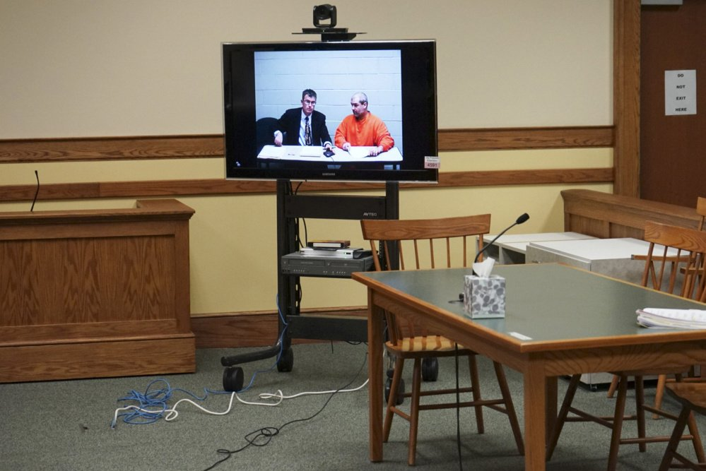 Christopher Hall, right, appears via video link from jail in Springvale District Court with defense attorney Randall Bates for Hall's initial appearance on assault charges for an attack on a lawyer using a cane equipped with a shocking device. Photo by Scott Dolan/Staff Writer