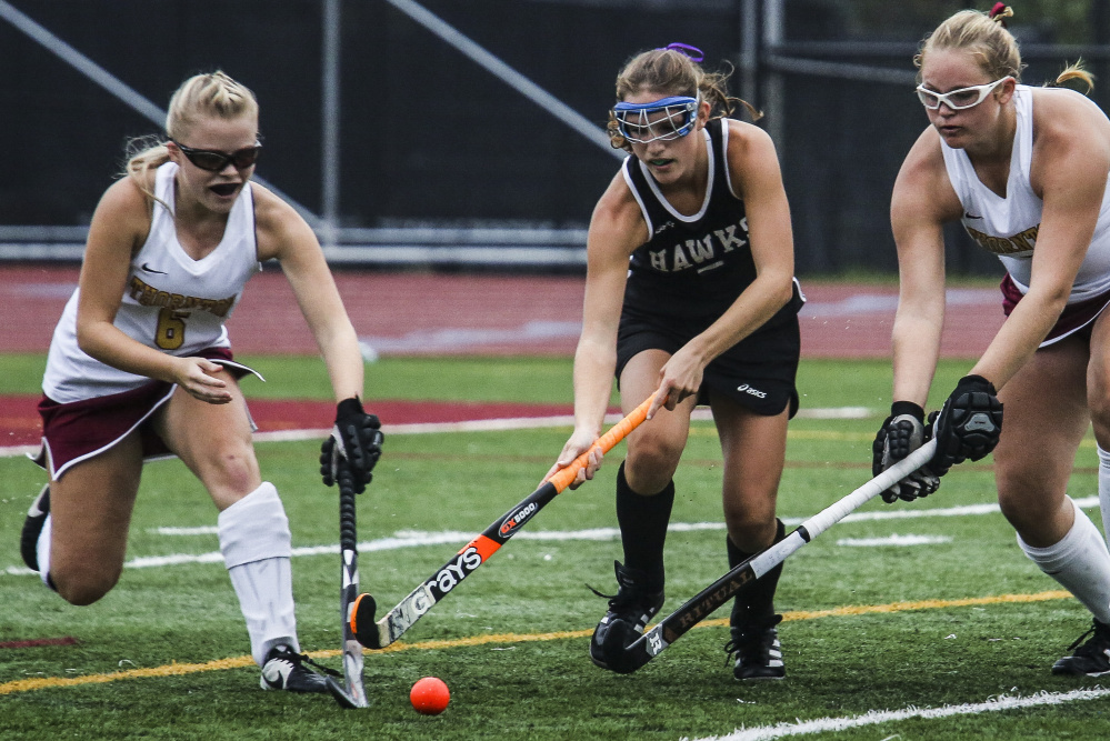 Thornton Academy's Sidney Hurst, left, and Grace Decker, right ,try to head off Marshwood's Leah Glidden in Tuesday's game at Saco. TA won, 1-0.