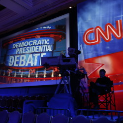 A camera operator waits in the debate hall before CNN's Democratic presidential debate Tuesday night in Las Vegas. Five candidates, Hillary Rodham Clinton, Jim Webb, Bernie Sanders, Lincoln Chafee, and Martin O'Malley, are set to take the stage.