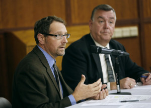 Dr. Christopher Pezzullo, left, seen with Kenneth Albert in October at the University of Maine School of Law, will continue as the state health officer while the Maine CDC operates without a director. Albert was the agency's director until May.