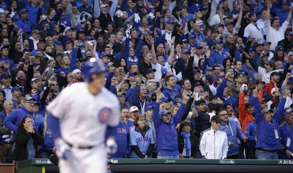 The fans cheer at Wrigley Field as the Cubs' Anthony Rizzo hits a tie-breaking home run in the sixth inning. The run proved to be the game winner as Chicago won the series over St. Louis, three games to one.