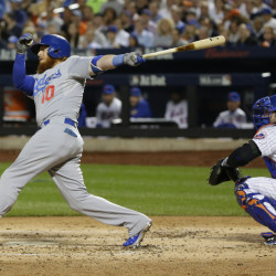 The Dodgers' Justin Turner follows through on a two-run double to left field in the third inning of Tuesday night's game. The two runs were all Clayton Kershaw and the Dodgers needed to win and send the National League Division Series to a decisive fifth game.